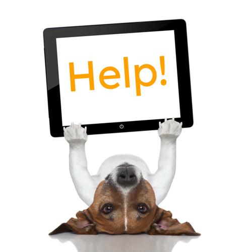 dog holding up 'help' sign